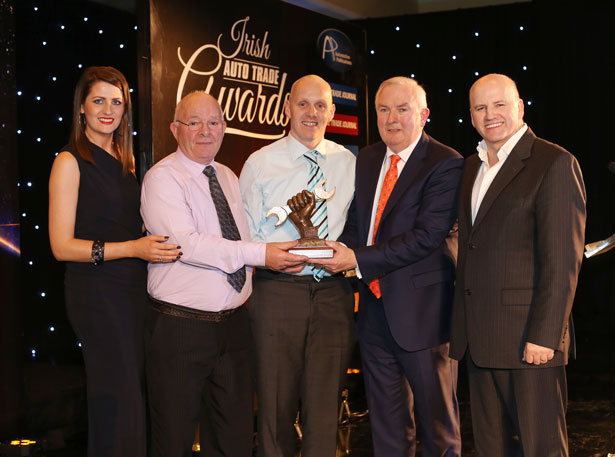 Pictured (L-R) at the Irish Auto Trade Awards were model Jessica McCarthy, Michael & Niall Nolan, M&N Nolan Motor Co. accepting his Independent LCV/HCV Workshop of the Year 2015 award last weekend from Padraic Deane, Managing Director Auto Trade Journal & Sean Gallagher (Master of Ceremonies).