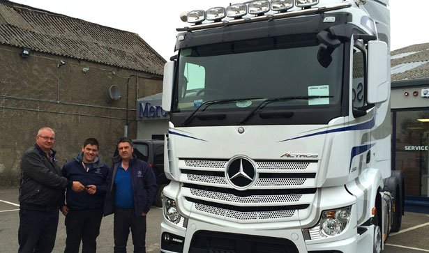 Martin Barnes with his son Nathan collecting his new Mercedes-Benz 2551 LS Actros from Pat Kenny (left) of Somers Commercials Ltd.
