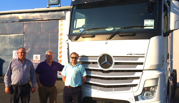 Photo Captions: Image 1: Paul Doyle(right) with Ivan Cummins collecting his new Mercedes-Benz 2545 LS Actros from Pat Kenny (left) of Somers Commercials Ltd.
