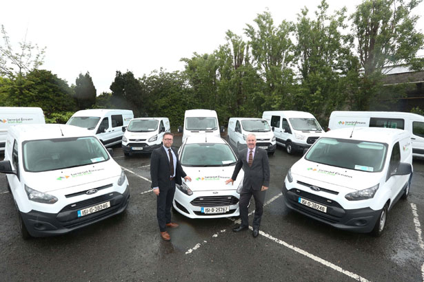 Tom Heffernan, Iarnród Éireann's Road Fleet Manager, with Ciarán McMahon, Chairman and Managing Director of Ford Ireland, and some of the company's new fleet of Ford commercial vehicles.