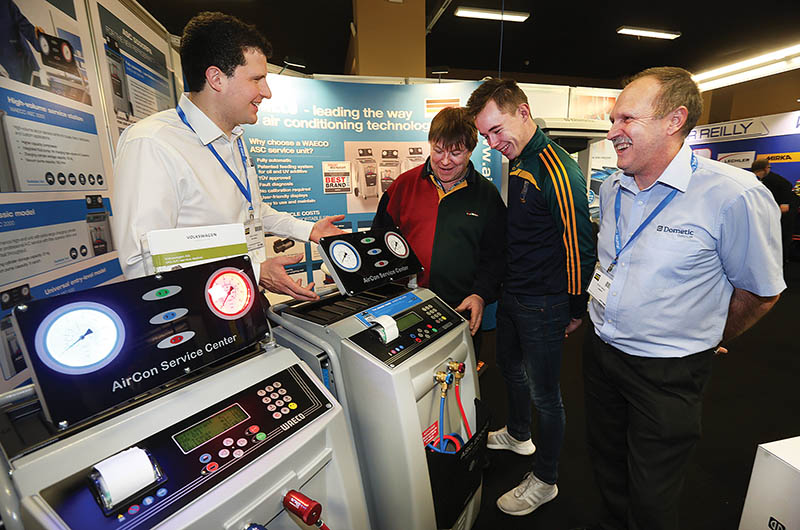 Adam Stewart (Gap Leisure), Customers Martin and Shane Dervin and Steve Davies (Domestic) at the Domestic Stand at the Auto Trade Expo in CityWest Dublin.