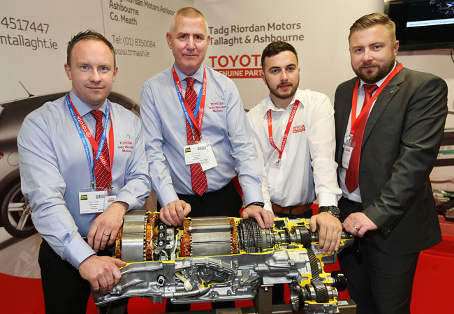 Colm Towey and Gay Brophy from Tadg Riordan Motors and Adam Hughes and Michael Oporowicz from Toyota Ireland at the Tadg Riordan Motors Stand at the Auto Trade Expo in CityWest Dublin.