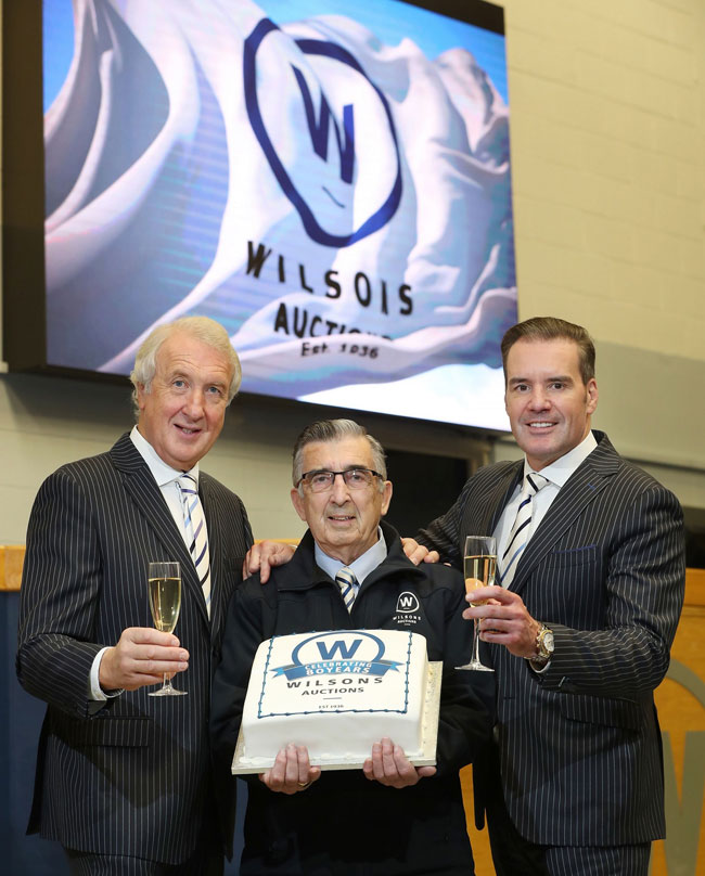 80 year-old Wilsons Auctions employee, Gerald Bigmore Snr joins in on the celebrations along with Managing Director, Ian Wilson and Group Operations Director, Peter Johnston as the company reaches its 80th. Anniversary.   Starting in 1936 as a single branch in Northern Ireland, Wilsons Auctions has grown to become the largest independent auction company in the UK and Ireland with sixteen sites including branches in Belfast, Dublin, Portadown, Dalry, Queensferry, Telford, Newcastle-Upon-Tyne and Maidstone.
